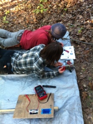 Building our water pump to bring water into camp.
